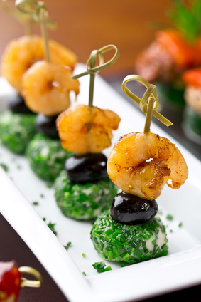 set of finger food - shrimps with black olives and cheese balls