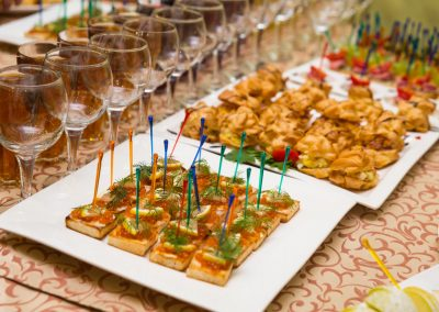 catering banquet table, Canapes on restaurant table, catering, buffet, canapés, stemware