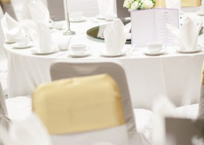 wedding table sets in wedding hall. wedding decorate preparation. table set and another catered event dinner, luxury wedding table setting for fine dining at indoors.